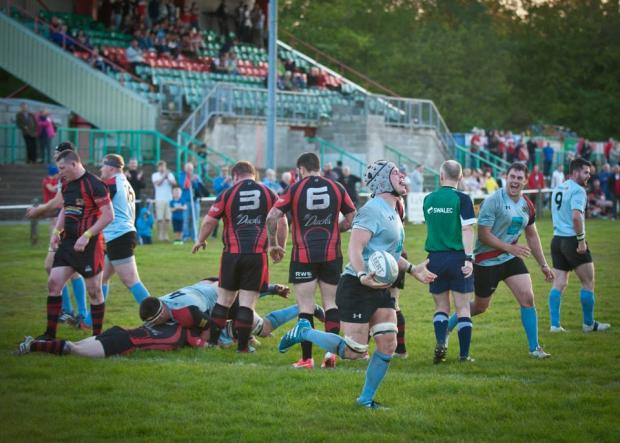 Milford Mercury: TRY TIME: Luke Hansford goes over for Tenby. PICTURES: TURFC.
