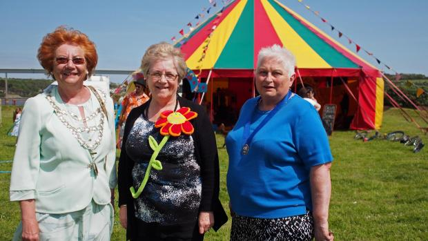 FUN IN THE SUN: Outgoing Mayor Maureen Molyneux with consort Jennie Rayner (right) and organiser Margaret Brace.