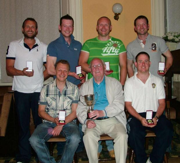 Milford Mercury: CUP WINNERS: Hook Sports Club team with D T Pearce Cup sponsor and former league treasurer Alan Gordon. (6381967)