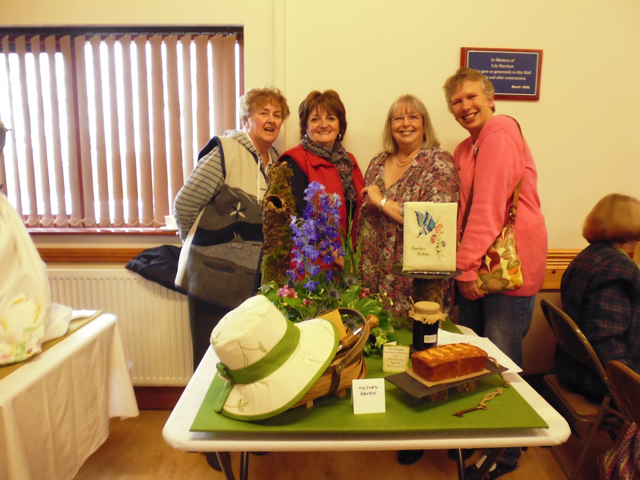 GREEN-FINGERED: WI members won a trophy for their entry A Secret Garden.