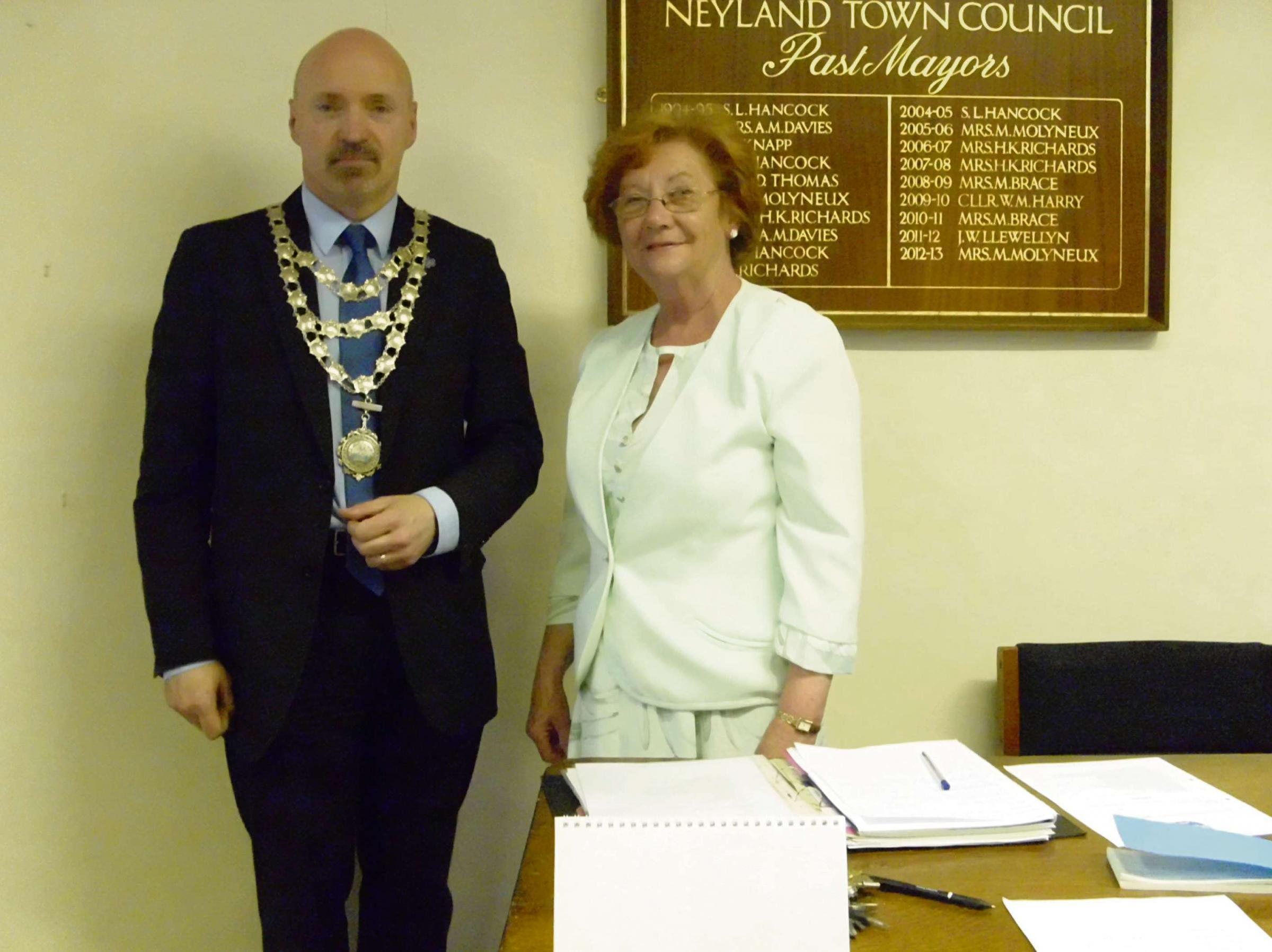 ALL CHAIN-GE: Cllr Maureen Molyneux has offically retired from Neyland Town Council, handing over to new Mayor, Cllr Simon Hancock. (6820678)