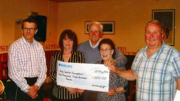 CHEQUE IT OUT: Niel of the Paul Sartori Foundation, Jackie Page, Mr and Mrs Williams and Paddy Davies chairman of the Manchester Club. (6793351)