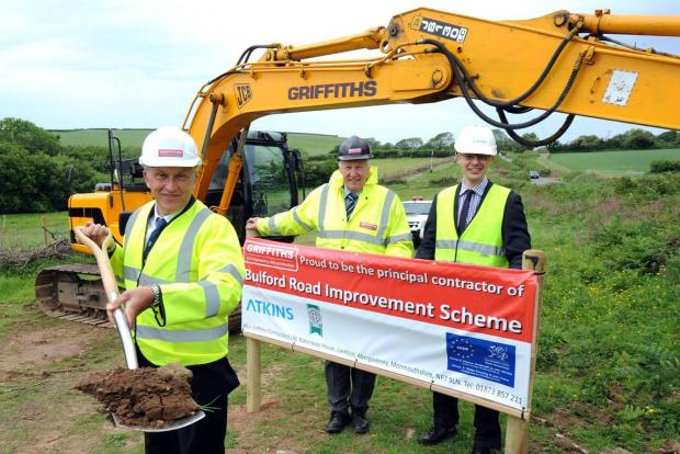 Councillor Lewis is pictured with Peter Evans, operations director for Alun Griffiths and Craig Cooley for consultants, Atkins.