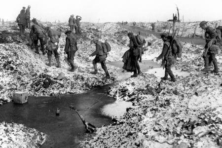 British soldiers negotiating a shell-cratered, Winter landscape along the River Somme in late 1916 after the close of the Allied offensive. (8709574)