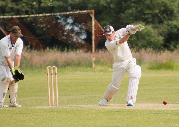 Milford Mercury: TOP KNOCK: Ben Jones drives a shot through the covers on his way to 46 for Llanrhian. (7397524)