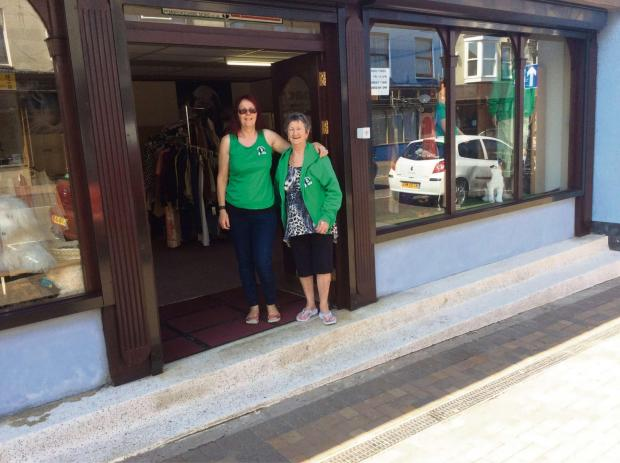 SETTING UP SHOP: Volunteers Georgie Pearson and Brenda Clark welcome customers to Greenacres' new premises.