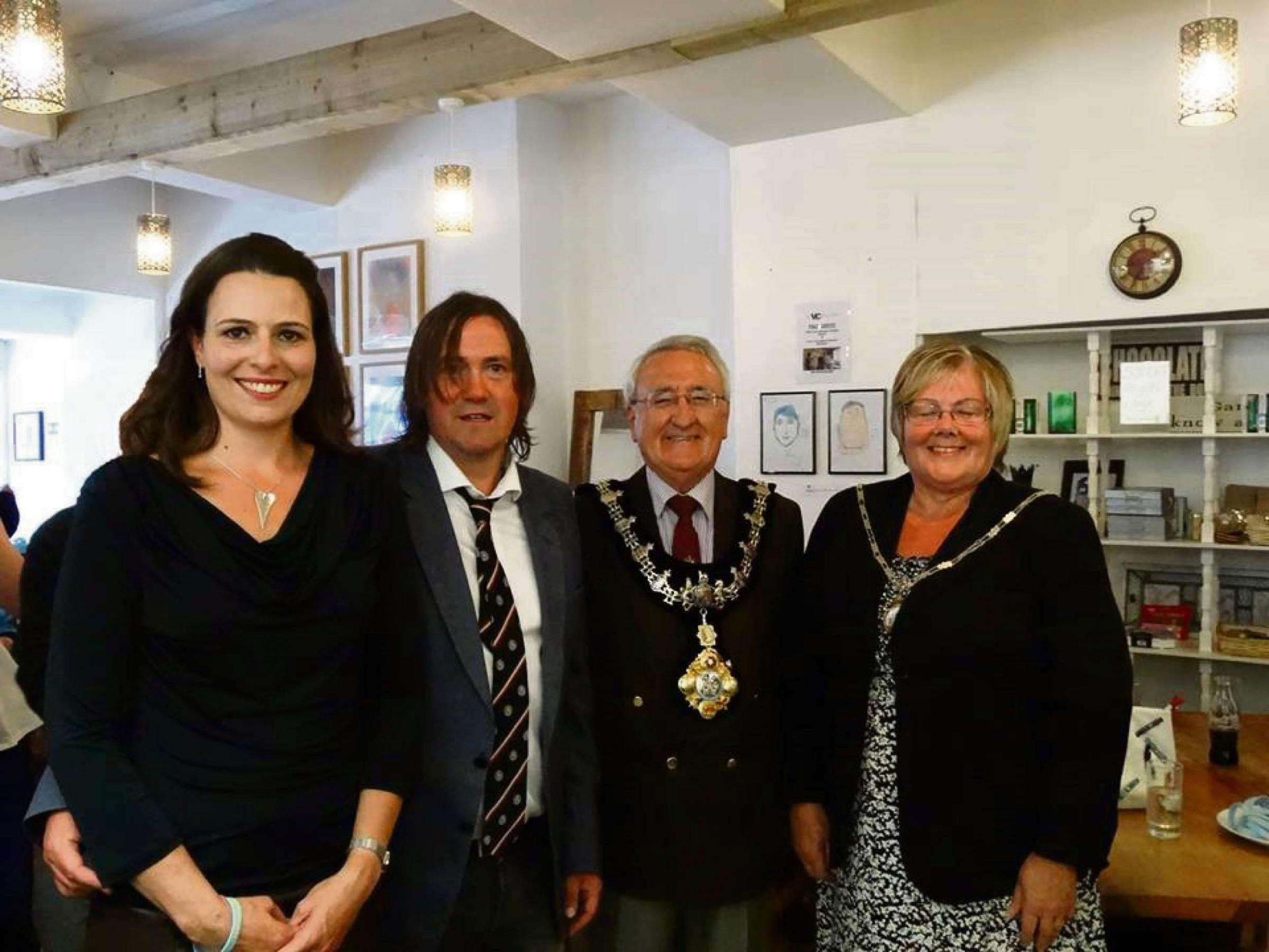 Barry John MBE pictured with Haverfordwest Mayor and Mayoress at an earlier exhibition opening.