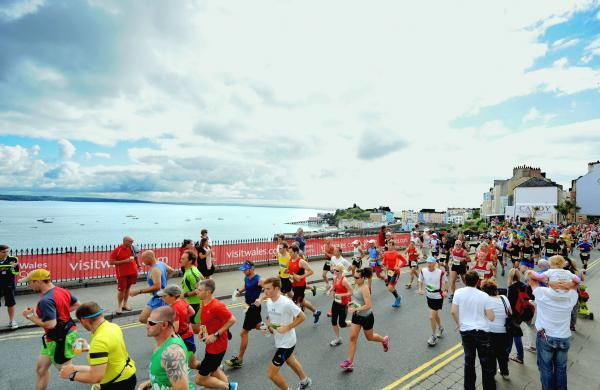 RUNNING FOR HOME: The first athletes set off from Tudor Square, Tenby, at