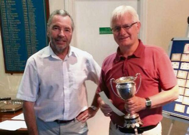 Milford Mercury: PRIZE GUY: Gelly James (right) receives the Investiture cup. (8088341)