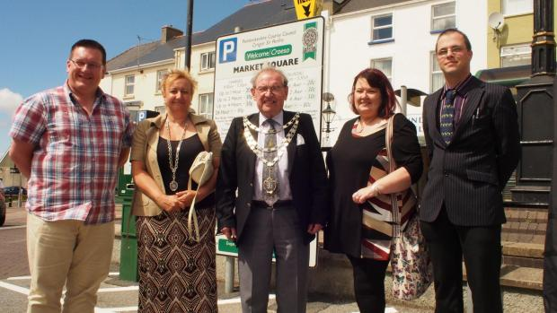 MARKET OPEN: Cllr Guy Woodham, Mayor Cllr Eric Harries and Consort Lynwen Harries, Lynne Turner of Milford Haven Business Circle, new market manager Byron Jenkins. PICTURE: Milford Mercury. (8286637)