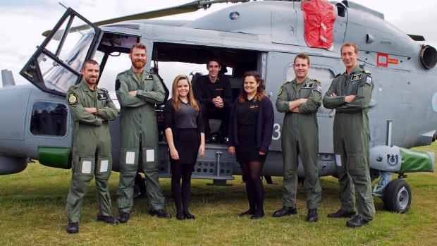 Milford Mercury: MEET THE CREW: Nirvana Thomas, Cerys Radcliffe and Ryan Beckerleg representing Milford Haven sixth form, with Petty Officer aircraft engineer Dai Williams, observer Rich Bell, pilot Lee Holburn and leading air engineering technician (mechanical) Clay Clay