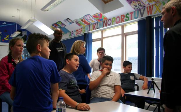 AMERICAN VISITOR: Public speaker, poet and writer Kevin Powell met children at Monkton Priory School recently. (8715199)