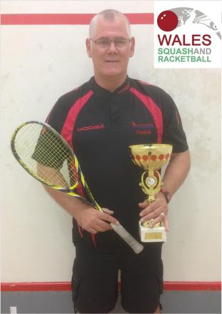 PRIZE GUY: Pete Crook with his squash coaching award. (8965376)