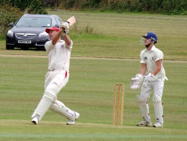 SIX APPEAL: James Caine hits a big six on his way to a top score of 69 for Saundersfoot. PICTURE: Western Telegraph. (9130453)