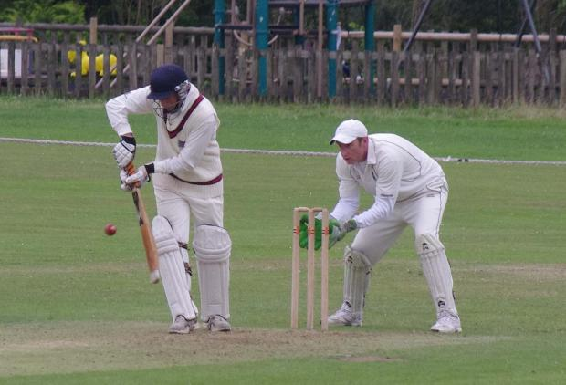 SOLID KNOCK: Paul Webb tickles a shot through the leagside for Whitland 2nds at Hook. PICTURE: Western Telegraph. (9415087)