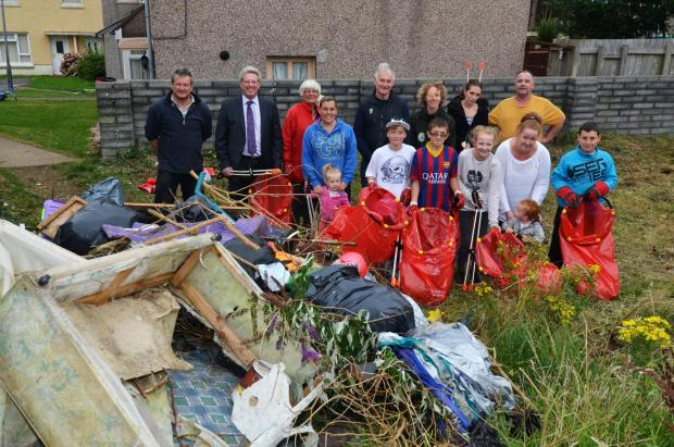 GETTING STUCK IN: Local residents, pictured at the start of the clean-up along with Ian Chalmers; Cllrs Simpson and Stoddart; Principal Environmental Health Officer Tom Hayes and Mari Williams from Keep Wales Tidy. (9745043)