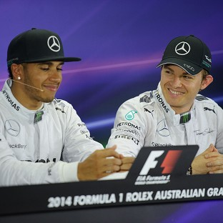 Nico Rosberg, right, has apologised for his collision with Lewis Hamilton at the Belgian Grand Prix