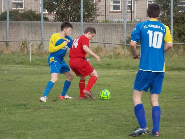 CLOSELY MARKED: Liam Davies tries to work space on the right wing for Milford.