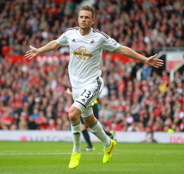 THE ICEMAN COMETH BACK: Gylfi Sigurdsson celebrates his opening day winner at Old Trafford, PICTURE: Huw Evans Picture Agency.