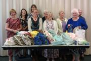 GENEROUS DONATION: Church Relief Society members with the 'comfort' bags. (10472986)