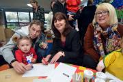 A FLYING START: Pictured at the new Meads Flying Start playgroup are Nathan Goffin and his daughter Sophie, with AM Lesley Griffiths and Cllr Sue Perkins.   (13097025)