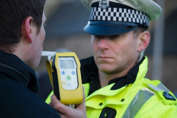 DRINK DRIVE. Police officers carry out a roadside breath test (library picture)..