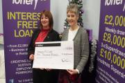 CHRISTMAS CHEER: Pictured receiving her cheque for £10,000, Amanda McCabe (left) from Narberth. PICTURE: Milford Mercury (14787714)