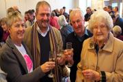 Toasting the new-look village hall are Sue Twidale, Mike Theodoulou, Stephen Ford, and Lily Devonald. PICTURE: Western Telegraph. (17160032)