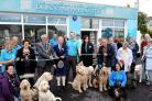 Pembrokeshire County Council ChairmanWynne Evans, cuts the ribbon to declare Burns@PetsCorner in Narberth open. Alongside him are company founder John Burns and the mayor of Narberth, Councillor Liz Rogers.  PICTURE: Gareth Davies Photography