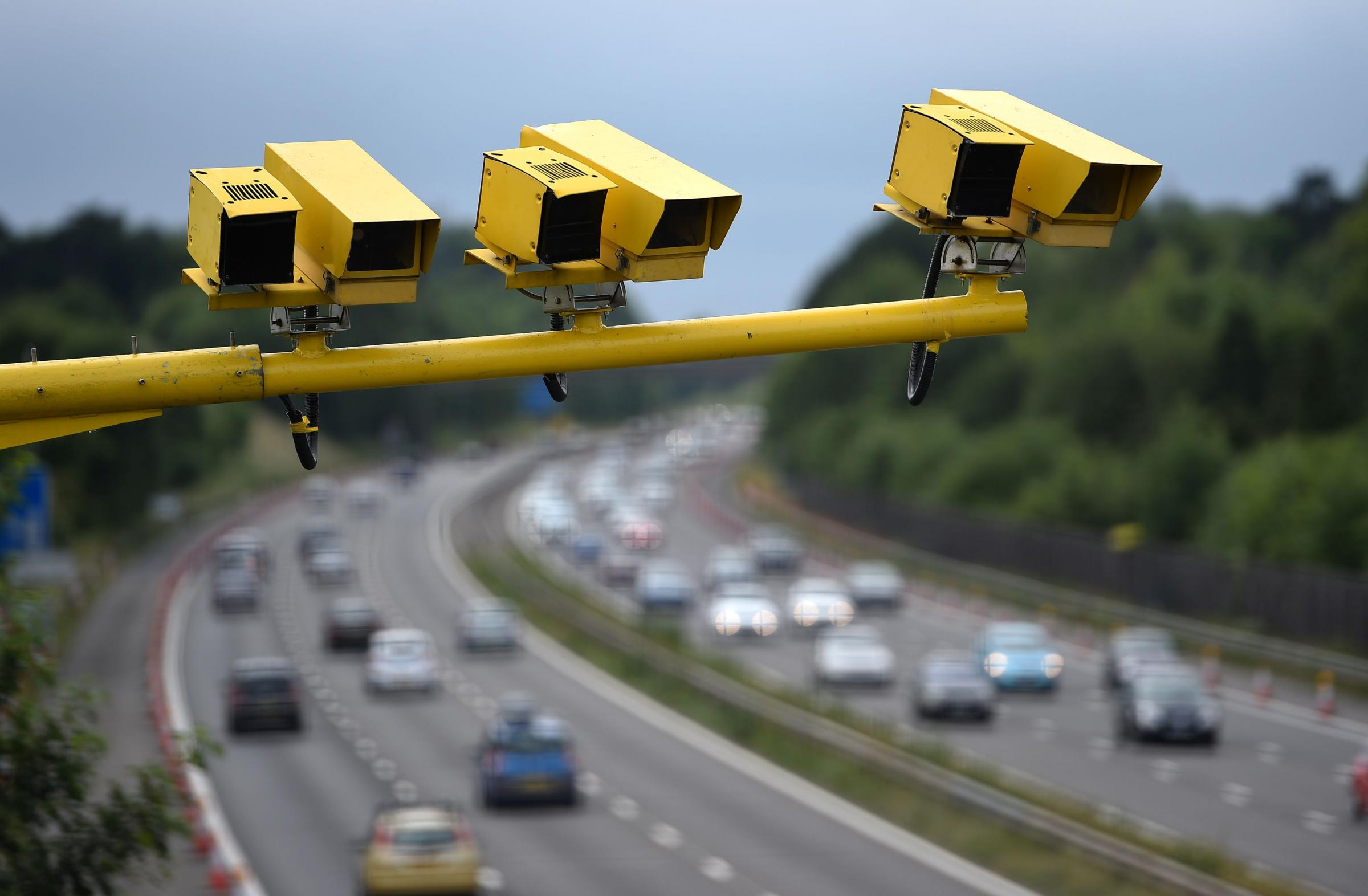 EMBARGOED TO 0900 TUESDAY MAY 31 File photo dated 28/06/15 of three SPECS Average Speed cameras in position on the M3 motorway in Hampshire, as average speed cameras are monitoring drivers on more than 250 miles of Britain's roads, according to a new