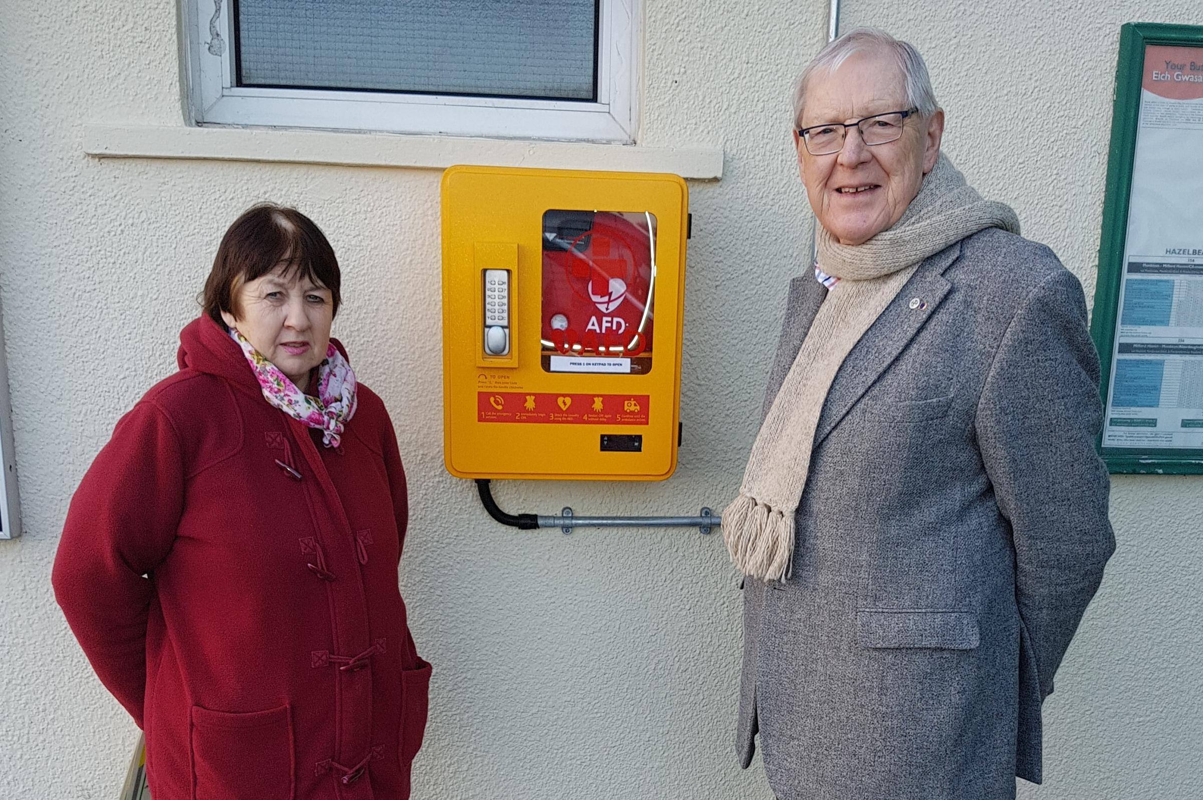 Pictured next to the defibrillator is Cllr Mike Howells (Chairman of LCC) and Cllr Mrs Judith Wilson.