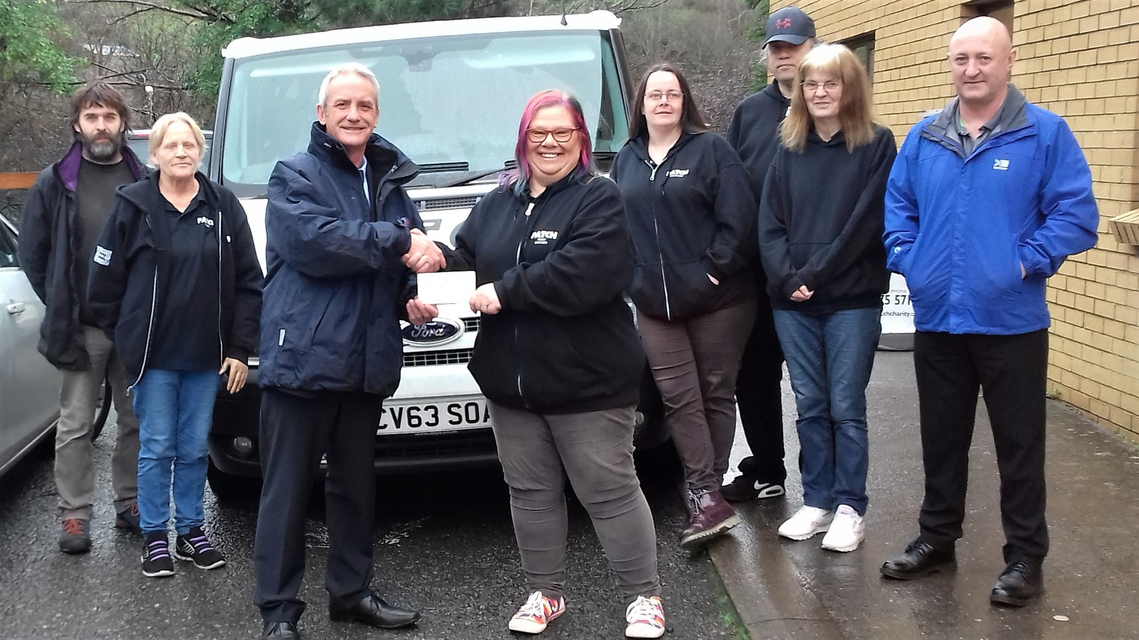 Mike Rogers of Bell Group presents £500 to PATCH Manager, Tracy Olin. Also pictured, PATCH volunteers and Stephen Barnett, Community Benefits Officer for Pembrokeshire County Council.