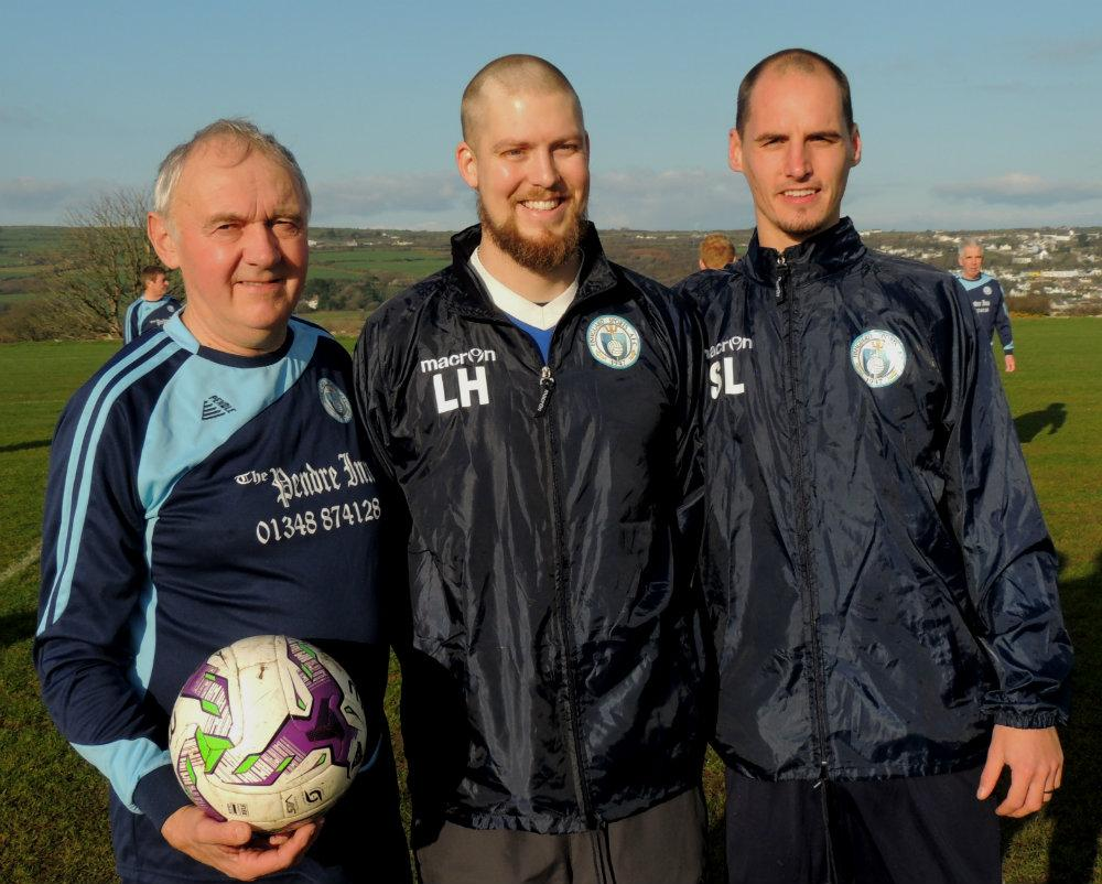 Luke Harding with John Luke and Steve Lewis at a special football match in Fishguard in December 2016, which he organised to raise funds for Ward 10 in Withybush. PICTURE: Western Telegraph.