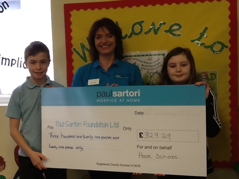School's Super Ambassadors, Liam Miller and Isabel Bown-Gainfort give Toni Dorkings, Community Fundraiser for the Paul Sartori Hospice at Home Service the cheque.