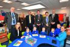 Council chairman Paul Harries, town councillor Yvonne Southwell, Cllr Bob Kilmister, Cllr David Lloyd, headteacher Nick Dyer, Mayor Colin Sharp, Kirsty Williams AM and pupils and staff.