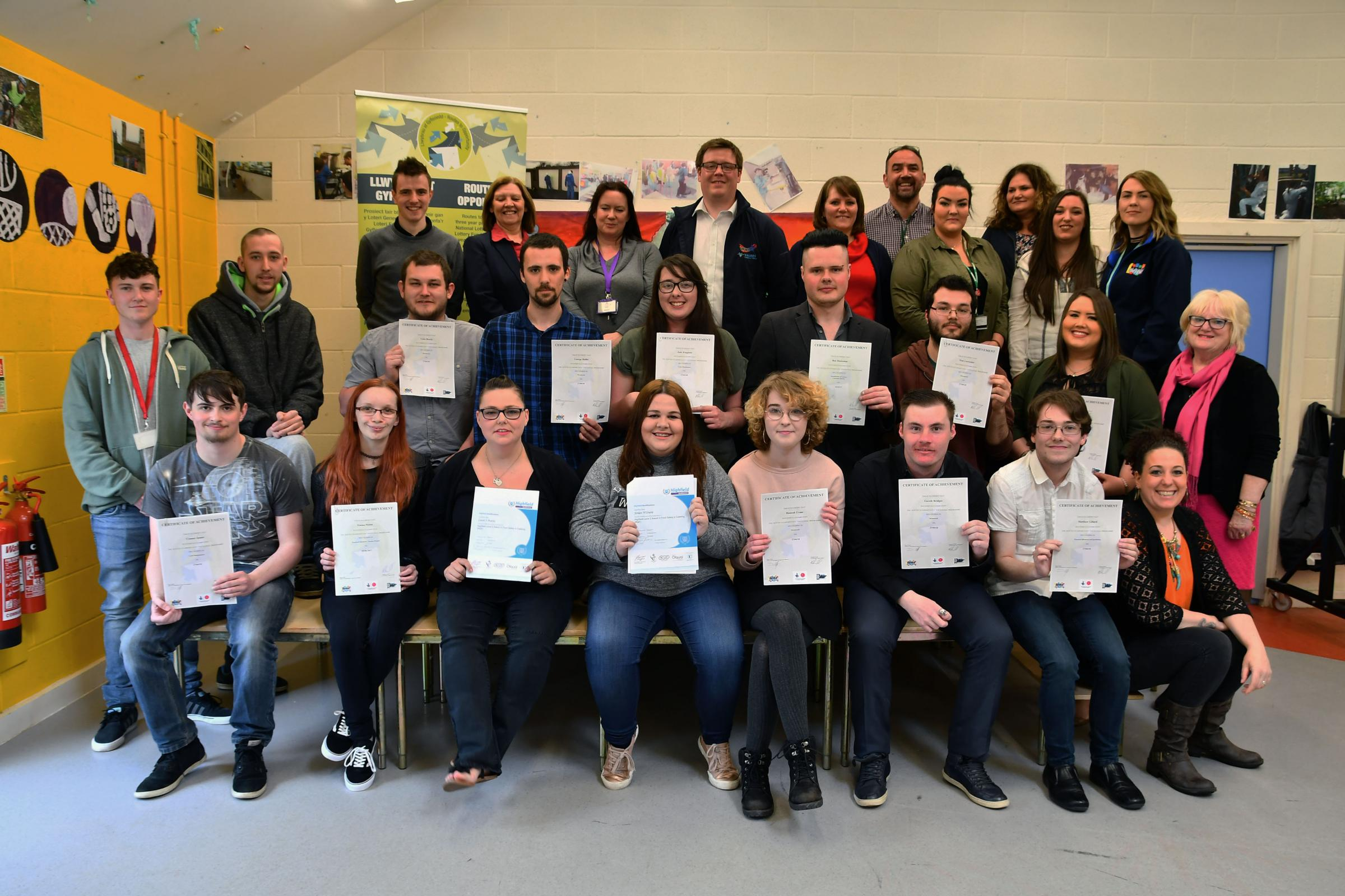 Routes to Opportunity participants with their certificates.