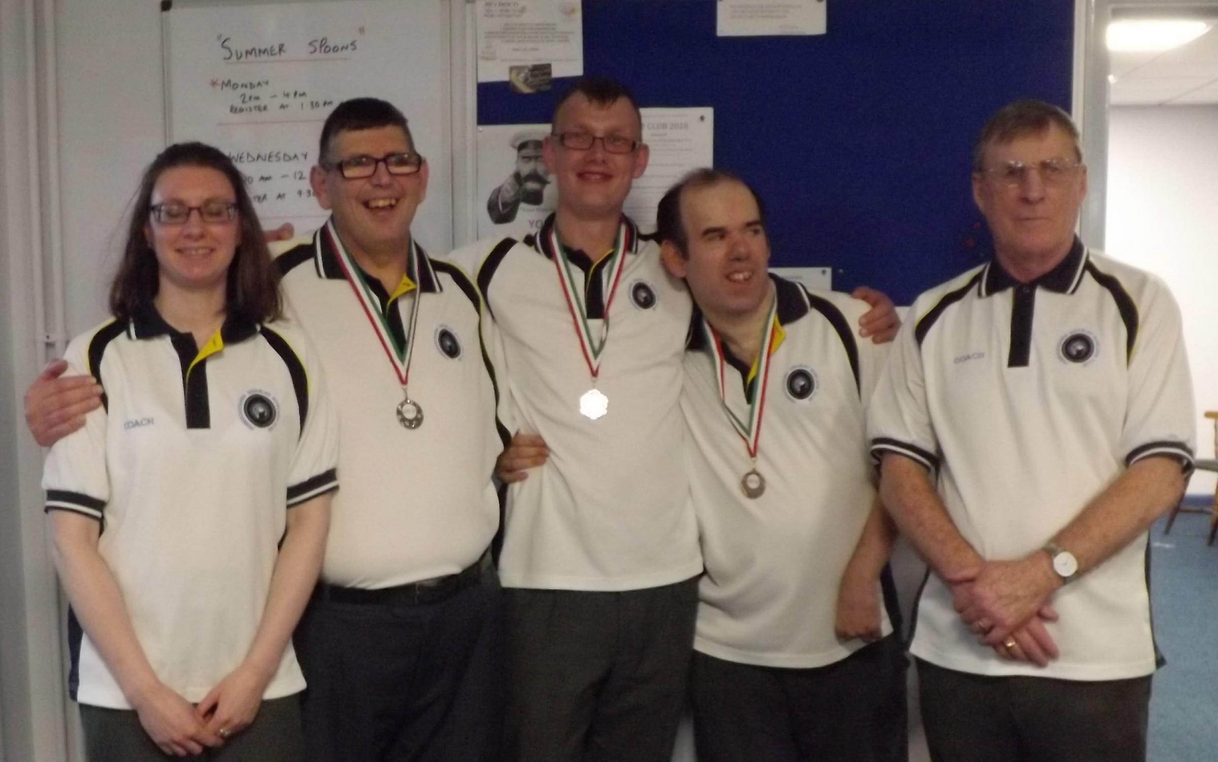 Pictured, from left: Maddie (coach) Simon Eaton (sil-ver), James Tyler (bronze), Lee Bower (bronze), and Steve (coach).
