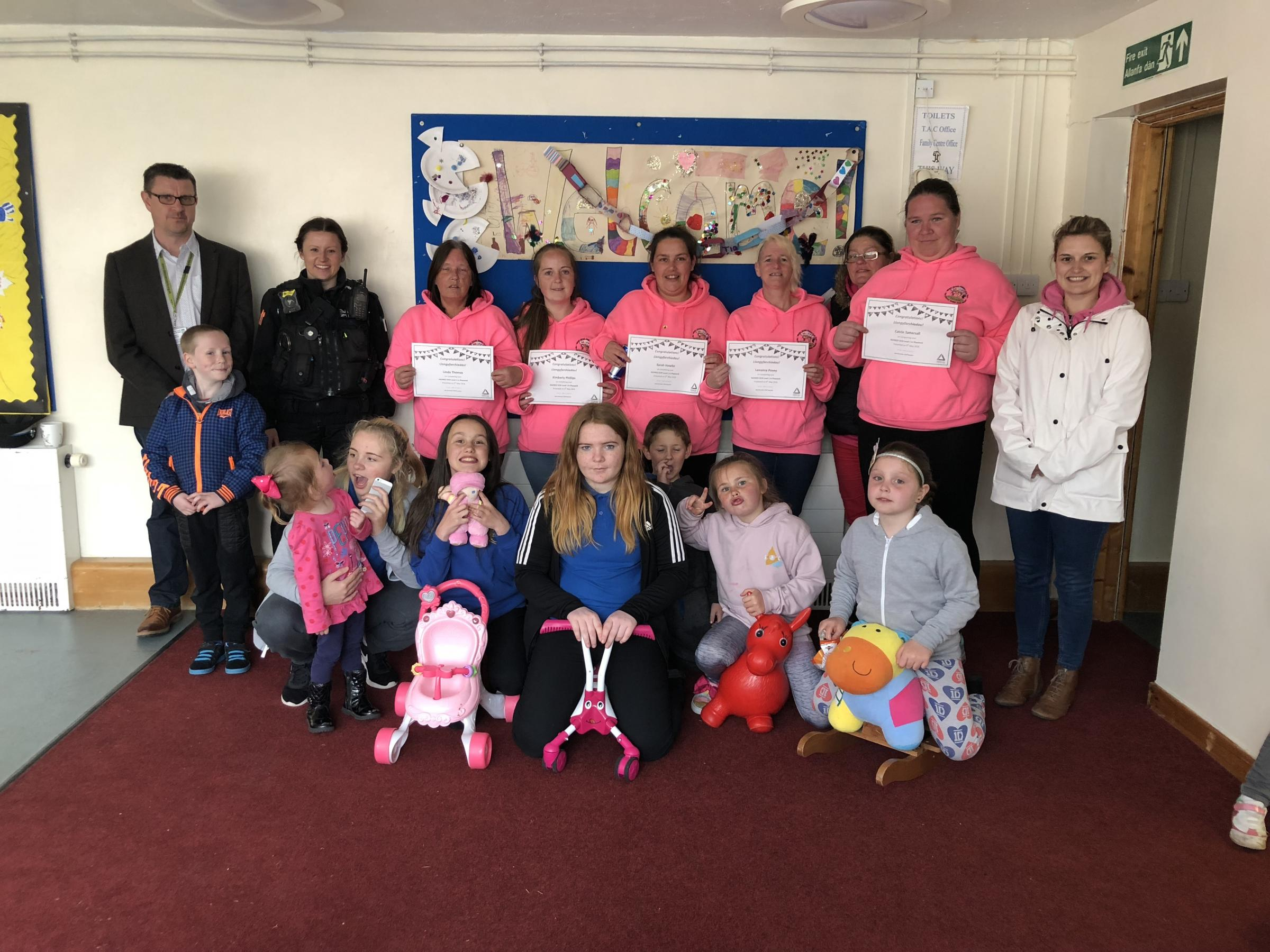 Pictured with some of the young people benefitting from the project are (standing, left to right) Damian Golden; PCSO Stacey Thomas; Parent Play Team members Linda, Kimberly, Sarah, Leeanna and, Catrin and Nia Davies, Council Housing Customer Liaison Offi