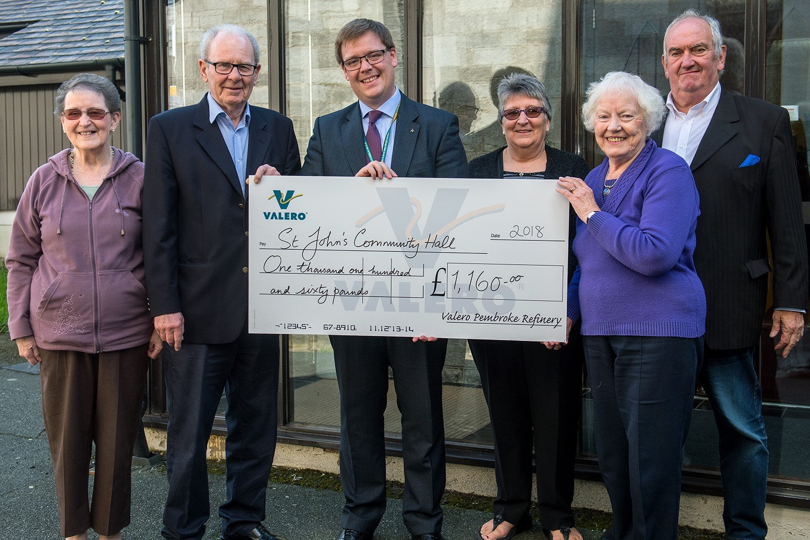 Valero's William James is pictured presenting a cheque to members of St John's Community Hall in Pembroke Dock.
