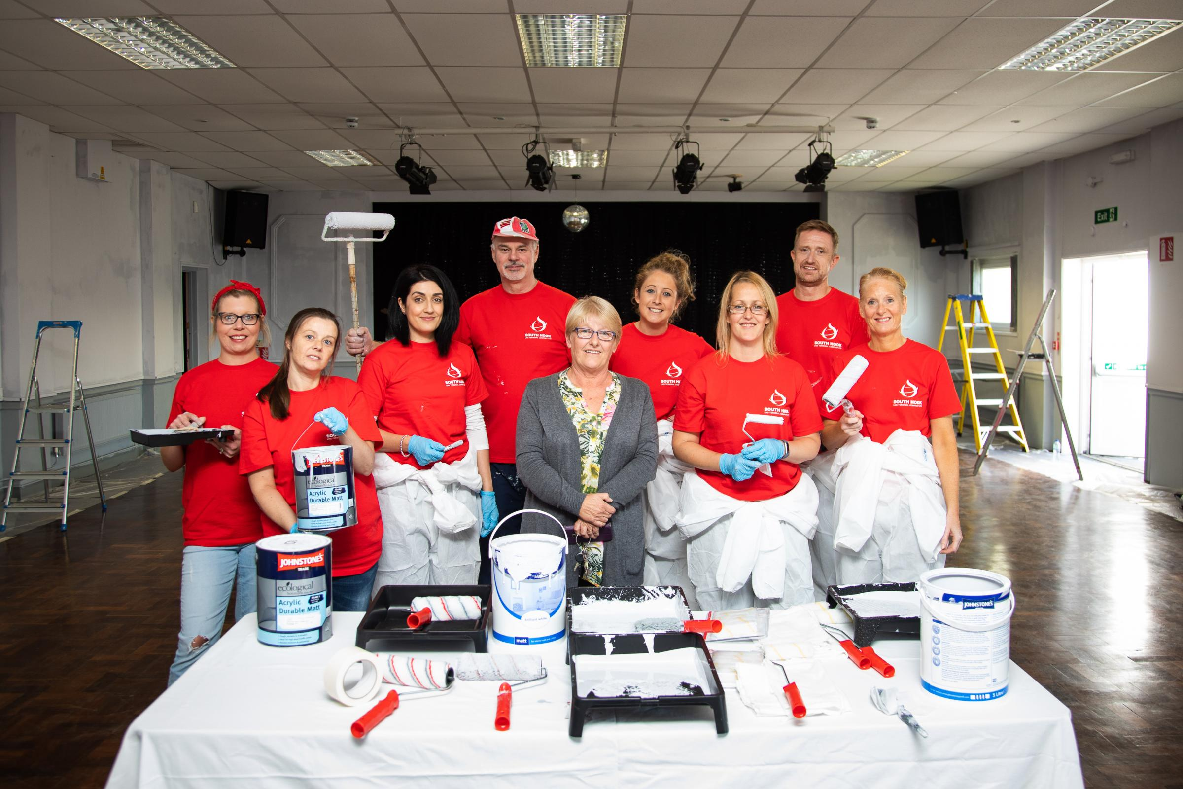 A team of volunteer painter and decorators from South Hook LNG, pictured with Teresa Evans, Trustee of the Centre.
