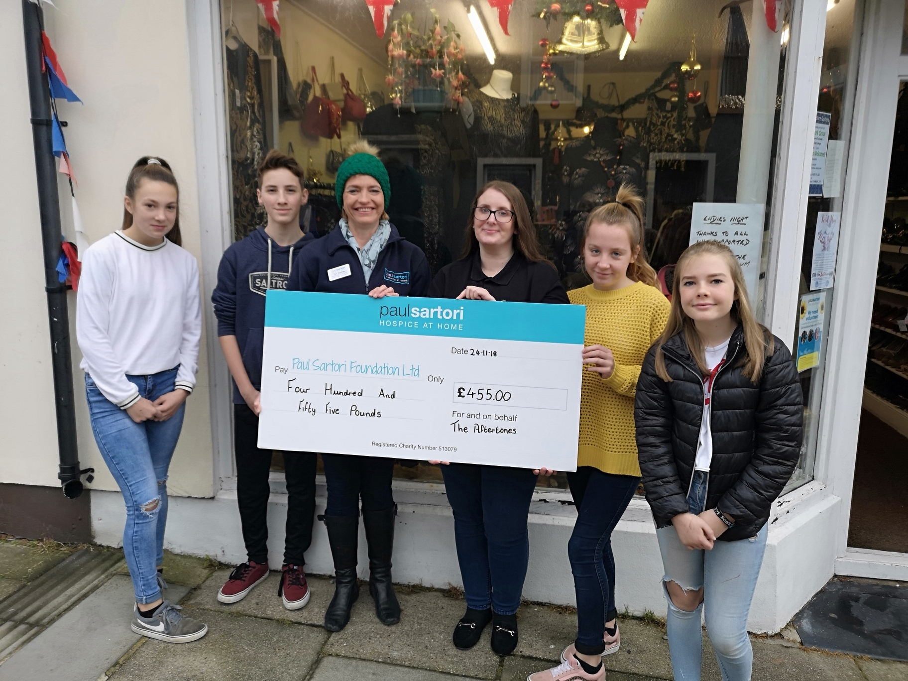 Serena Williams-Jones, James Elliot, Toni Dorkings, Helen Boyce, Gabrielle Power and Cara Regan. The youngsters pictured are Duke of Edinburgh students that volunteer every Saturday in Paul Sartori stores, Neyland.