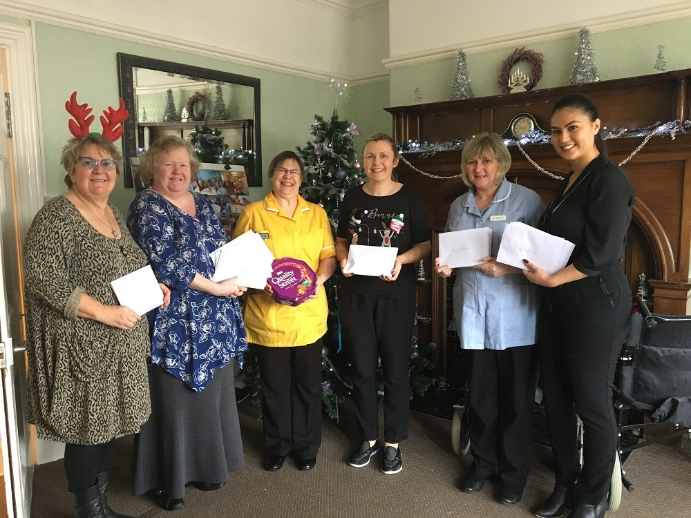 Natalie Hunt and Cheryl Langton with staff at Havenshurst residential home.