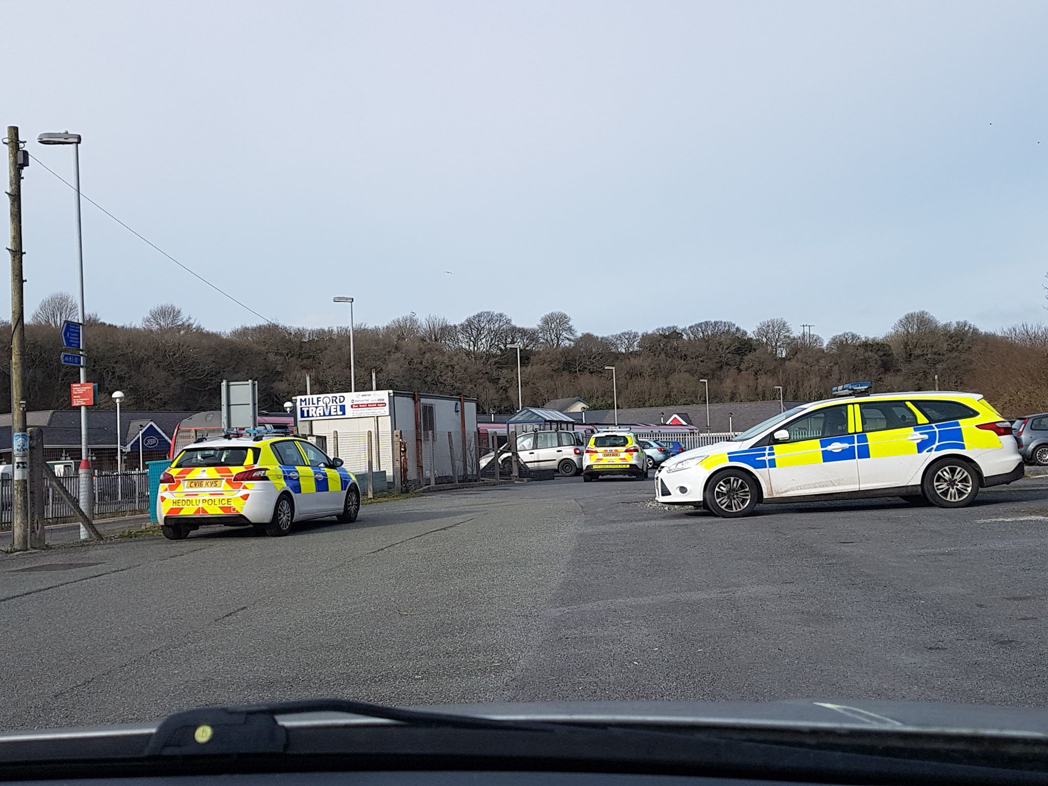Police attending the incident at Milford Haven railway station.