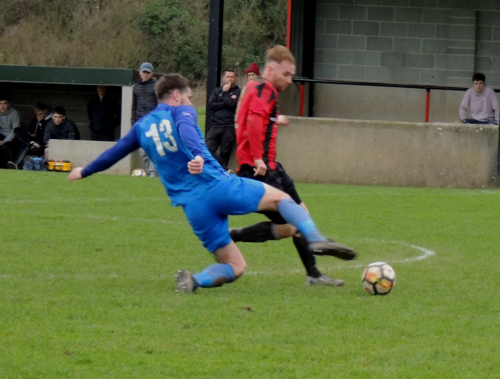 Carew's Alex Bayley puts a strong tackle on Goodwick's Chris O'Sullivan