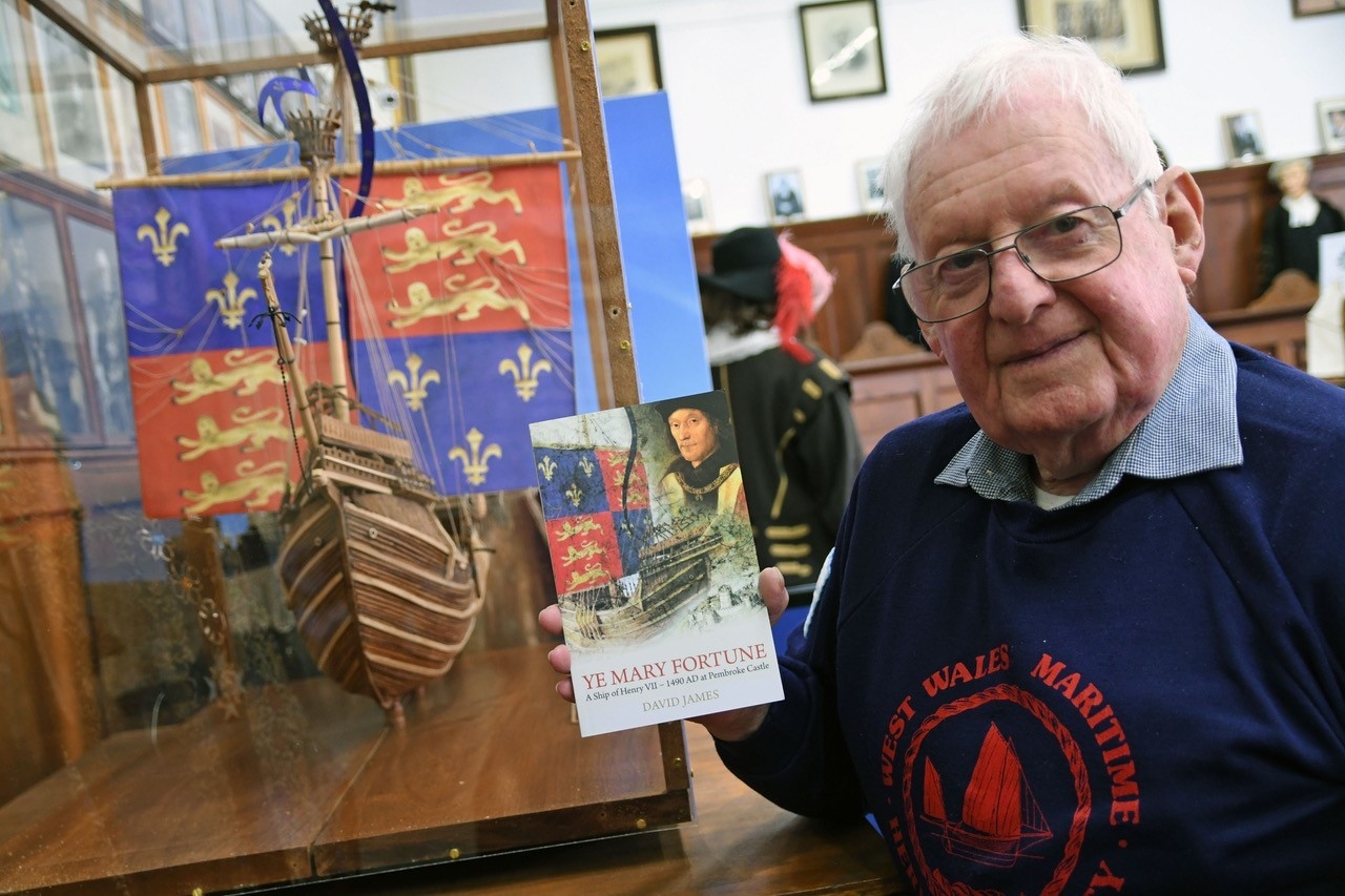 David James with his new book Ye Mary Fortune and a model of the ship he constructed. PICTURE: Martin Cavaney