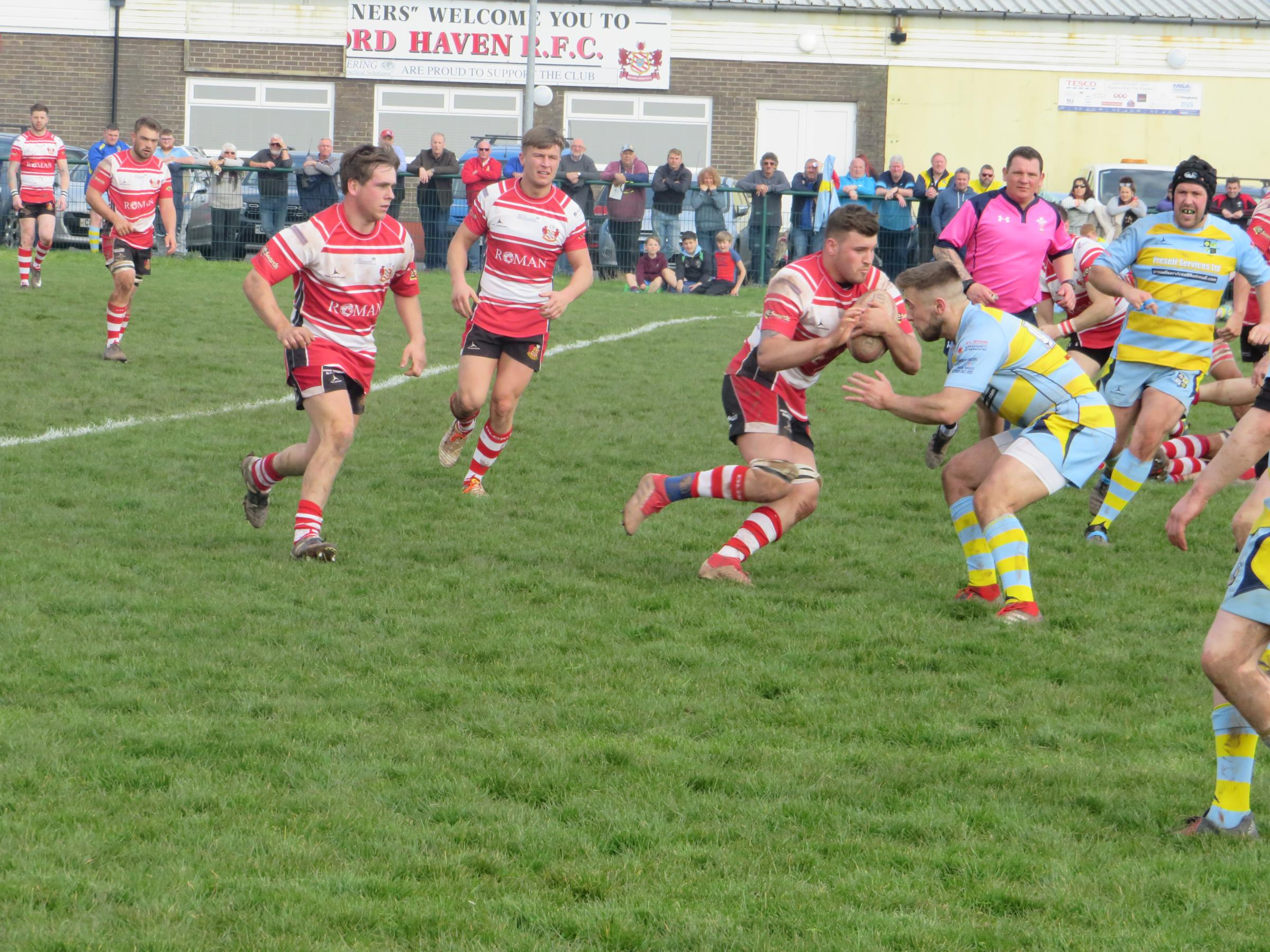 Ryan Mansell on his way to a try treble at The Obs. PICTURE: Western Telegraph.