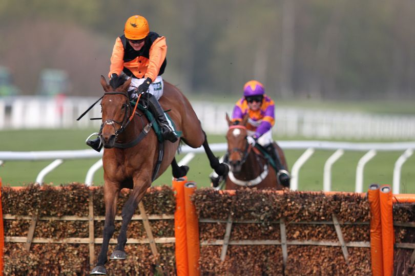 Tobefair and Tom Bellamy clear the final fence yesterday. PICTURE: PA Wire.