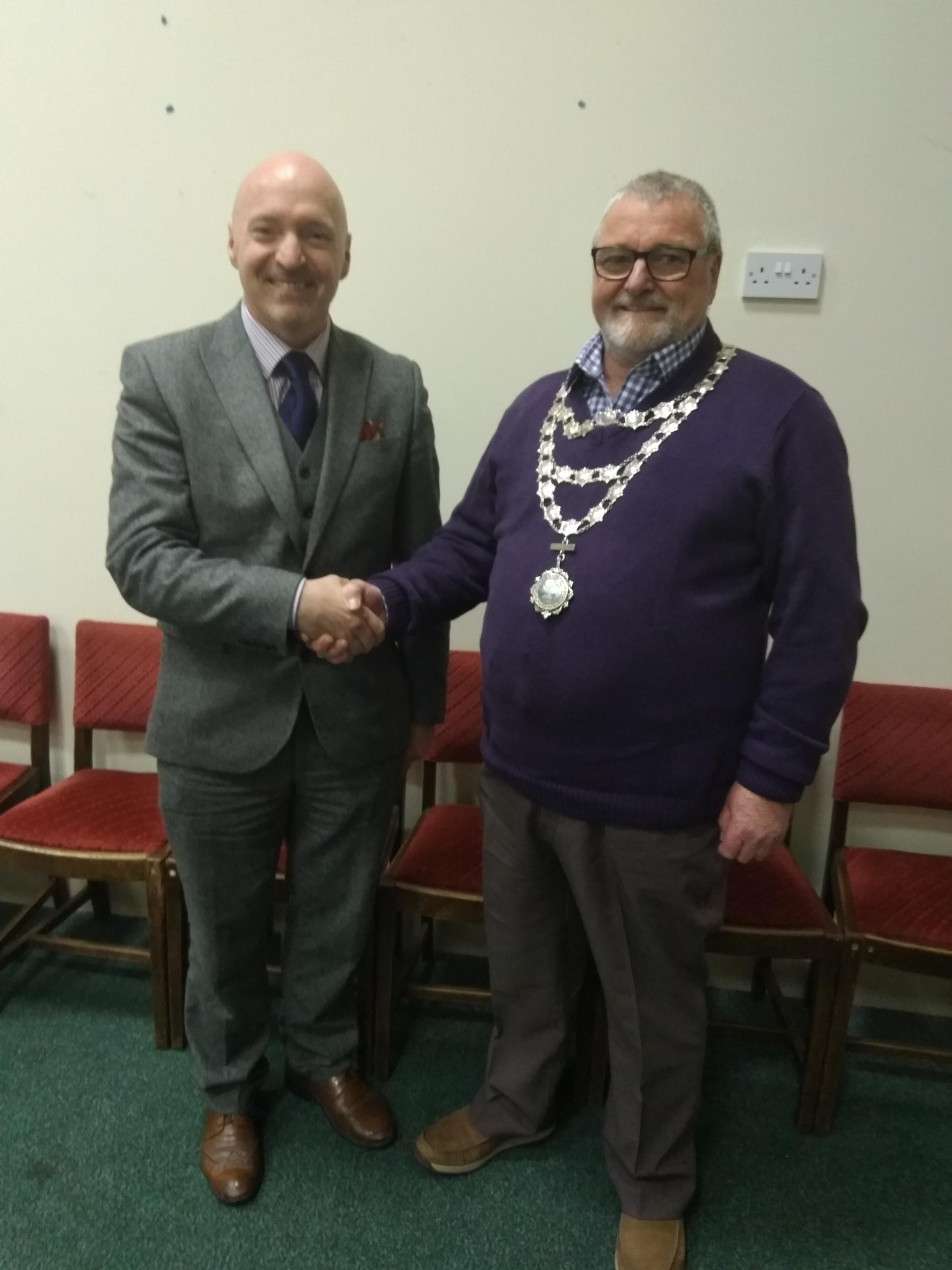Outgoing mayor Cllr Simon Hancock with incoming mayor William McGarvie