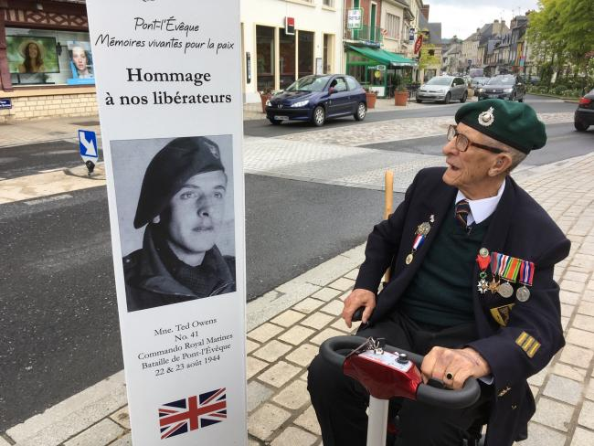 Ted Owens comes face-to-face with his younger self on a poster proclaiming him as a liberator of Pont L'Eveque. PICTURE: Greg Lewis.